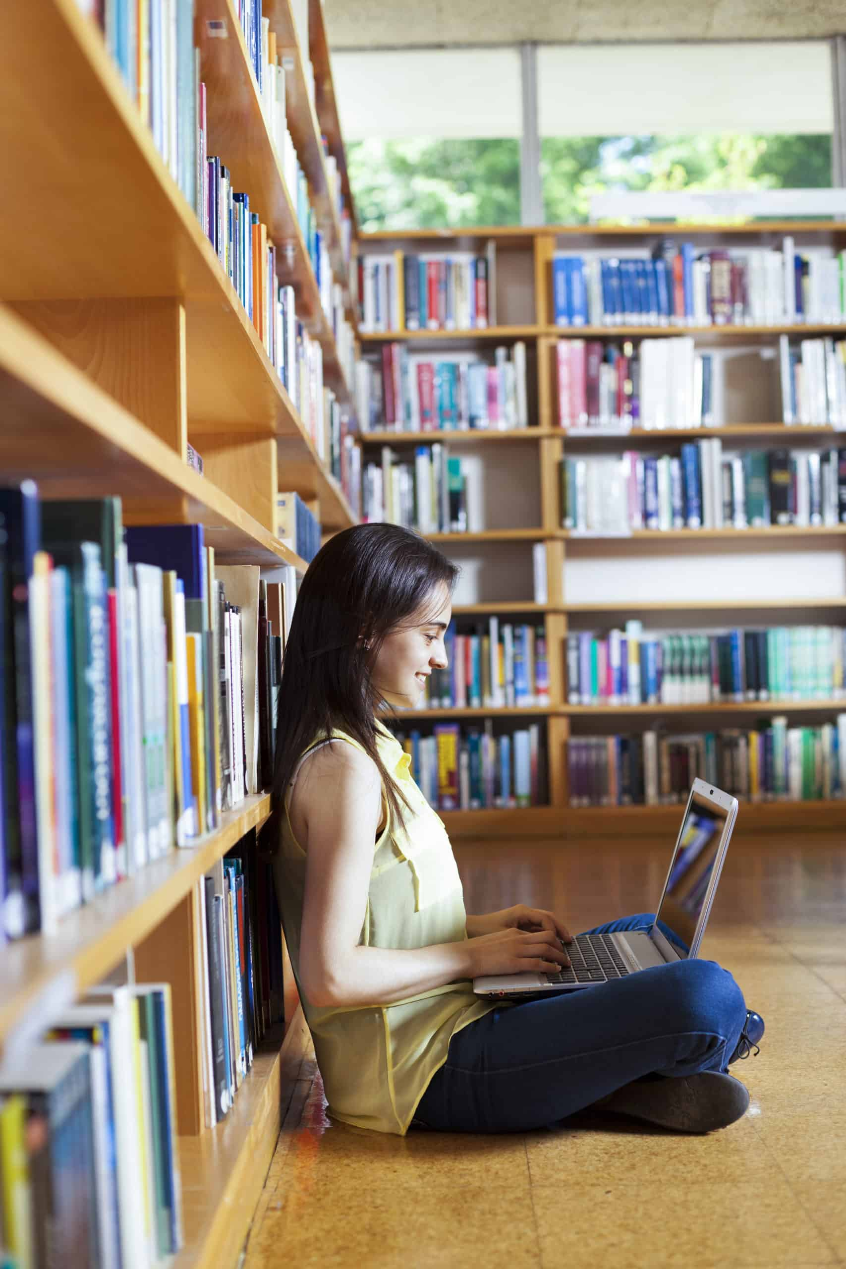 Labster - Community college student learns in library